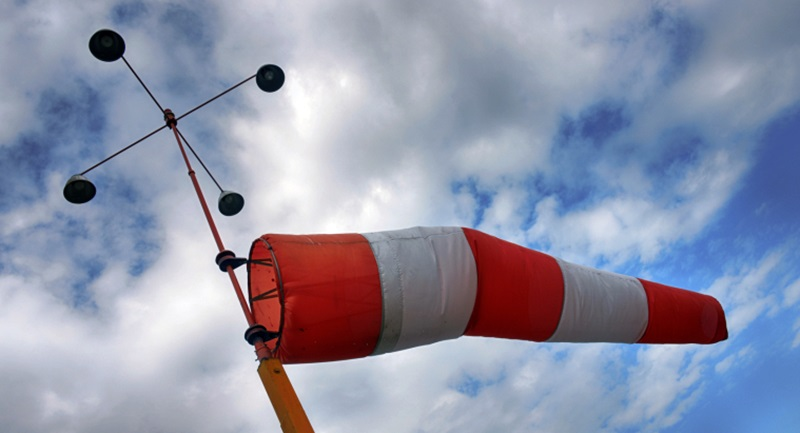 Wind sack with cloudy sky and aerometer.