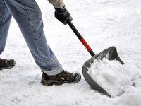 Man shoveling snow after a heavy snowfall